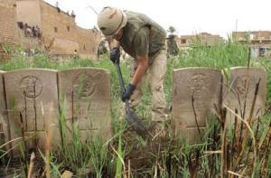 A US Marine restoring Kut War Cemetery 2003